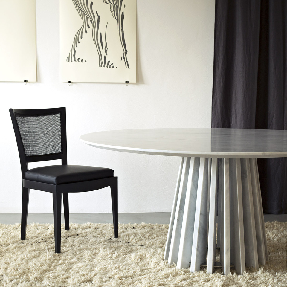 Grey Round Aria Dining Table featured with other furniture