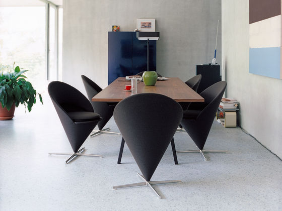 Black Cone Lounge Chair featured in a conference setting with other furniture