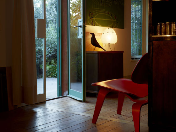 Eames House Bird Accessory featured in a living room setting with other furniture