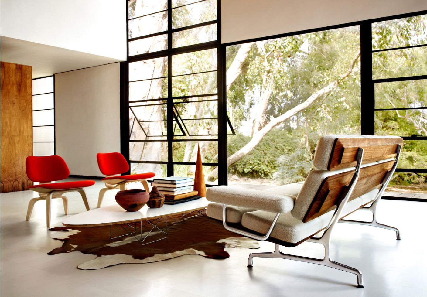 White Eames Molded Plywood Highback sofa with Wood backing and metal frame and legs