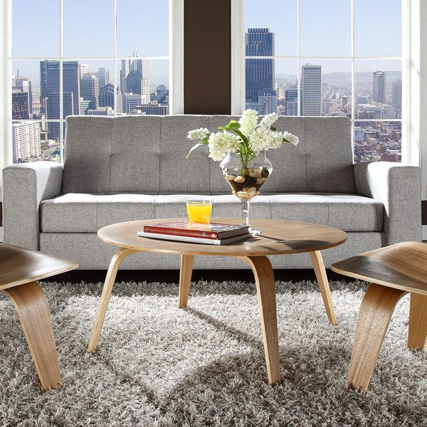 Eames Moulded Plywood Wood Pattern Coffee Table with Depressed Center featured in a living room setting with other furniture