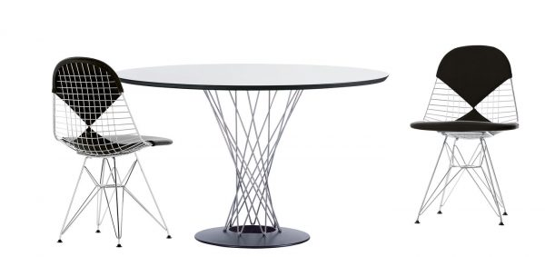 Round Noguchi Dining Table with Metal Support and Base featured with other furniture