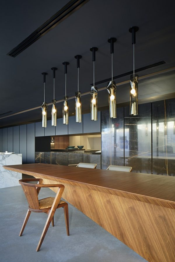 Press Pendant Lamp with Light Fixture featured on a bar with other furniture