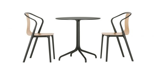 Belleville Round Table with dark tabletop and metal legs, featured with other furniture