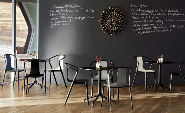 Black Belleville Round Table featured in a dining setting with other furniture