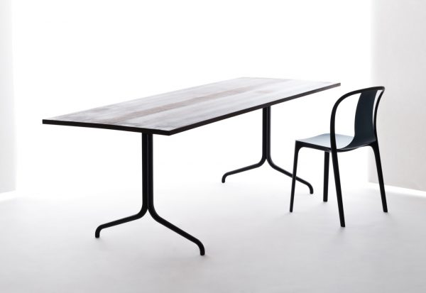 Rectangular Belleville Table with wood pattern tabletop and dark metal legs, featured with other furniture