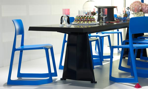 Blue Tip Ton Chairs featured in a dining setting with other furniture