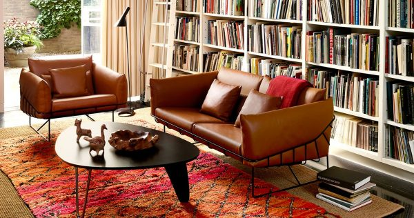 Tan Coloured Wire Frame Sofa featured in a living room setting with other furniture