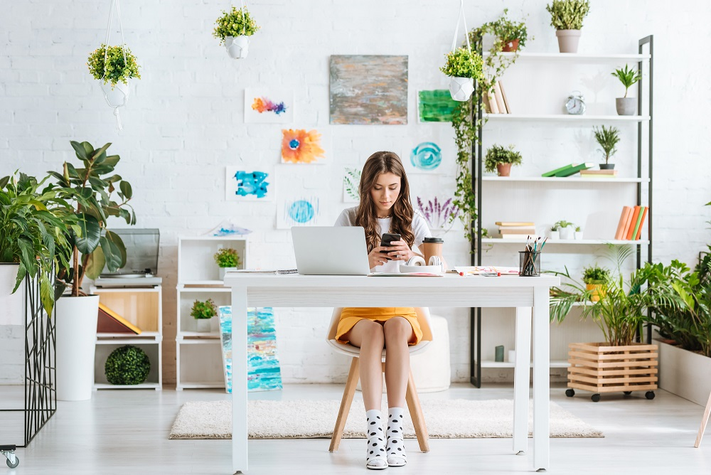 woman in her home office with plants