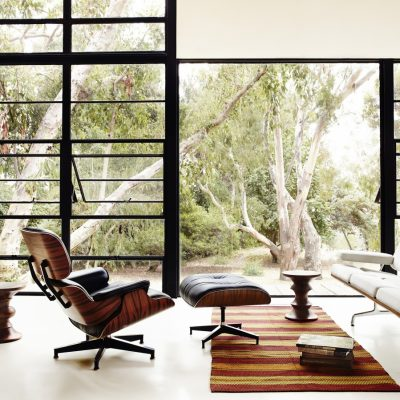 Eames Lounge Chair and Ottoman featured in a living room setting with other furniture