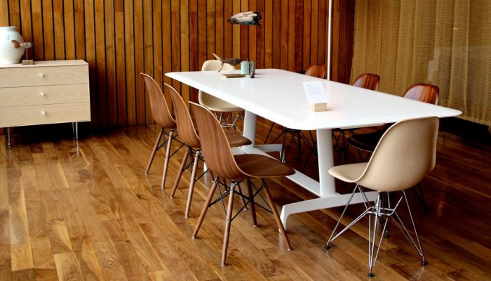 Eames Moulded Wood Side Chair featured in conference setting with other furniture